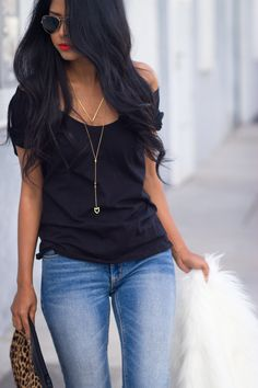 This is my look most of the time. A black top and jeans never fails. To pump up the volume, add the leopard clutch for attitude.