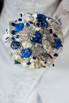 Ruby Blooms is pleased to offer you the Premiere Collection - Royal Blue Silk Flowers wedding brooch bouquet. Designed for White and Blue Wedding Bridal Flowers and Special Events! Brooch Bouquet Spec