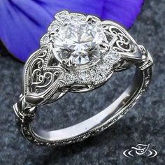 My Custom Jewelry Design at Green Lake Jewelry Works Custom Platinum intricate hand fabricated antique style filigree with halo milgrain bead set diamonds, top and side face hand engraved with scroll detail. Center Fire & Ice diamond set with delicate claw prongs
