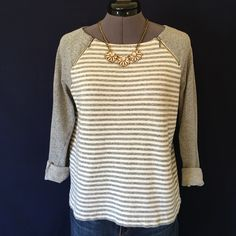 Stripe French Terry Zip Top by LOFT Adorable!! A feminine take on the traditional sweatshirt. Gray and white stripes on the body with solid gray arms. Raglan long sleeves, &  jewel neck. Zip accents at the shoulder seams channel prep cool style. See closeup in pic #2. French terry material, 100% cotton. Bust measured flat across is 19 inches, & back of neck to hem is 20 inches. Size Small, TTS. In Excellent condition with No wear or tear. LOFT Tops