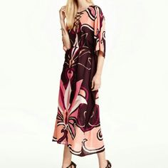 H&M Patterned Dress Long wide-cut dressing woven, patterned fabric. V-neck , decorative lacing at neckline,.and short, wide sleeves. Besides tie belt at waist with tassels. Unlined   100%polyester Machine wash cold H&M  Dresses Long Sleeve