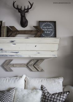 rustic neutral living room and mantel with wooden arrows