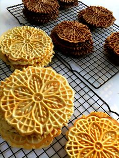 I've always wanted to make pizzelles, especially ones dusted with powder sugar to give away as gifts during the Holidays. Recipes on this blog include a basic pizzelle, a chocolate one & an anise flavored one. Guess I better get a pizzelle maker first :)