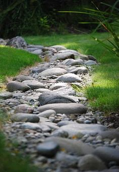 stone river running through garden..... when you can't have the real thing :)