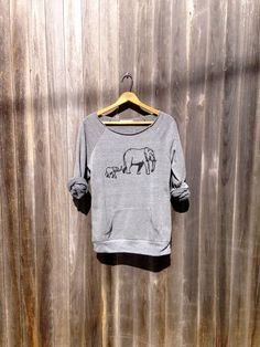 This cozy sweater. | 32 Things Every Elephant Lover Needs In Their Life
