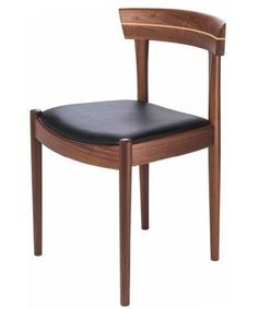 The Somerset Dining Chair has an American walnut frame with a black upholstered seat. A very nice mid century modern dining chair.