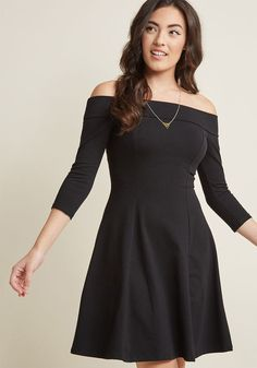 Off-Shoulder Knit Dress in Black - Who knew an A-line dress so sassy and stylish could simultaneously be so comfy to wear? Part of our namesake label, this black, jersey knit skater dress is characterized by an off-the-shoulder neckline, 3/4-length sleeves, and oh-so-much personality!