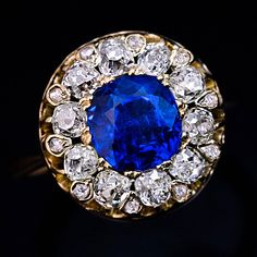 A late 19th century antique ring set with a vivid royal blue sapphire from Burma surrounded by old mine cut diamonds.  The richness and consistency of the color and the velvety texture of this unheated and untreated sapphire is due to fine rutile silk inclusions that disperse light. The color and saturation is truly exceptional.  #sapphires #vintagejewelry #vintagering #vintagelover #vintagerings #estatejewelry #jewelryphotography #ringstagram #showmeyourrings #engagementring #sapphirering…