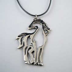 Sterling Silver Outline Zen Horse Necklace. Bold brush-like outline of standing horse. Looking out to the distance with quiet intent. If only we could emulate Zen like horses. Perhaps the necklace wil