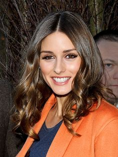 """CENTER-PART CURLS  Middle parts can be tricky to pull off (they can sometimes seem dowdy and flat), but as Olivia Palermo demonstrates, waves make all the difference. Use a curling iron for shiny loose curls – and avoid volumizing products to minimize the dreaded """"triangle effect."""""""