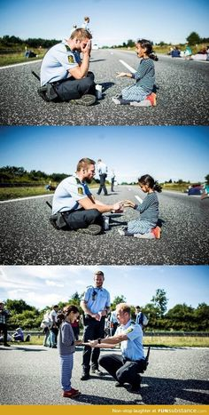 Danish officer playing with Syrian refugee girl