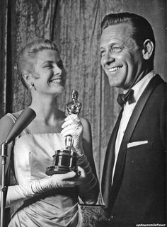 Grace Kelly after receiving her Best Actress Academy Award for 'The Country Girl' from co-star, William Holden in 1955. Photo by Murray Garrett.