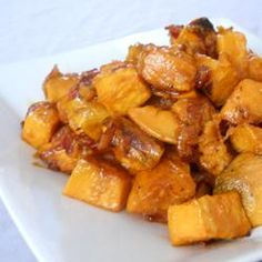"Maple Glazed Sweet Potatoes with Bacon and Caramelized Onions |""I made this for Thanksgiving dinner and my family went crazy over it. It is simple, looks great on the table and has already been requested for Christmas dinner!"""