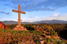 Wooden cross at edge of the village of Truchas, New Mexico in the Sangre de Cristo Mountains of New Mexico, between Santa Fe and Taos, NM  COPYRIGHT:Randall K. Roberts