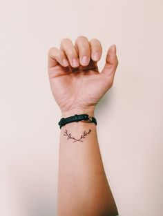 Olive branch on the wrist- olive branch symbolizes peace. It also signifies hope, after Noah sent out the dove when the flood was over, a dove flew back with an olive branch signifying there's dry land