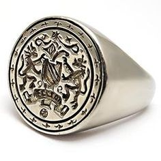 Vintage Mens Crest Seal Ring Solid 18 K White Gold.   Even though it's intended for men I'd still wear it. It's pretty bad ass.