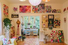 Carrie Schmitt's beautiful painting studio. Carrie's story is inspiring as is her workspace. Love those big windows.