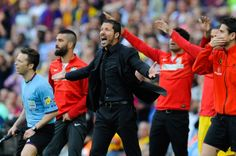 Head coach Diego Pablo Simeone of Atletico de Madrid reacts during the La Liga match between FC Barcelona and Club Atletico de Madrid at Camp Nou on May 17, 2014 in Barcelona, Catalonia. Atletico de Madrid won the Spanish league La Liga.