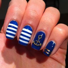 Nautical cobalt/navy nails with white stripes, gold metallic stripes & beaded anchor. J'adorable!!