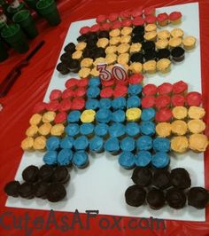 Mario Birthday Cake Cupcakes--- 37 Red Cupcakes 24 Brown (Chocolate Frosting) 7 Black 2 Yellow 42 Skintone 31 Blue