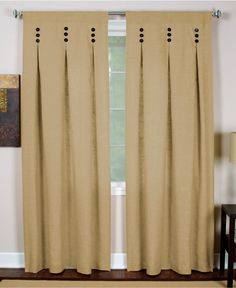 A streamlined design with inverted pleats gives the Murano window panel a modern sensibility. Wooden buttons stacked in sets of three accent this linen-like panel in solid neutral shades. With back ta