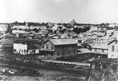 Downtown Grand Rapids; Central High School is in the background on the hill. - c. 1870s