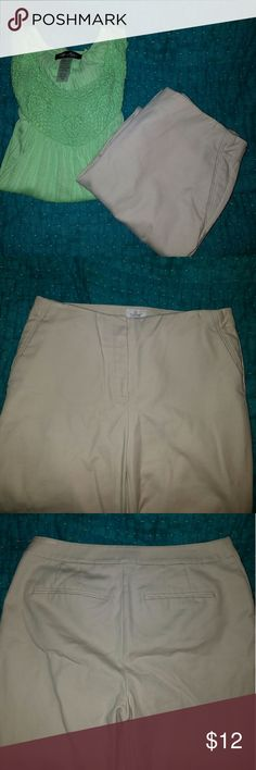 Chicos So Slimming Capris So Slimming Chico's capri pants. Light khaki color. Capris have cuffs on leg opening. Slit side pockets and back pockets. Size Chicos 1 (4-6 womens). Waist 32 inches. Inseam 23.5 inches. Chico's Pants Capris