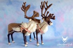 Pair of needle felted reindeers in Christmas tacks by SaniAmaniCrafts.deviantart.com on @DeviantArt