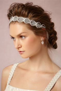 I used to do this with ribbon and a headband, but this is elegant and classy!  A definite Yes!    Looped Tulle Head Wrap from BHLDN