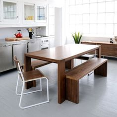 Gus Modern Dining Set with Bench The Modern Plank Dining Room Sets are a modern interpretation of the traditional harvest table, with warm, walnut grain wood finish, and legs that showcase solid wood