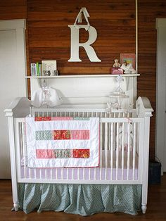 Andrea Fowler, of Keeping It Cozy, lives with her family in a 1930s farmhouse with wood-paneled walls and floors, a perfect setting for a vintage nursery for her second daughter, Rosetta. Don't forget to remove everything from the crib before you put Baby in it.