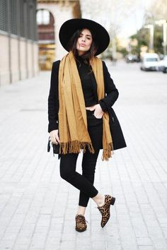 Make your black skinny jeans feel fresh: wear them with a big hat, black turtleneck, and leopard flats.