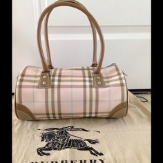 Authentic Burberry pink barrel bag Authentic pink Burberry barrel bag M Size 12/6/7 .bag in excellent condition like new !  very barely used .exterior and interiors bag very clean .only one tiny stain see pics last pics 4 #Original dust bag included ! Pls ask if you have any questions ! Thx Burberry Bags Shoulder Bags