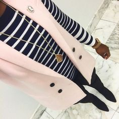 work outfit with blush vest and striped sweater