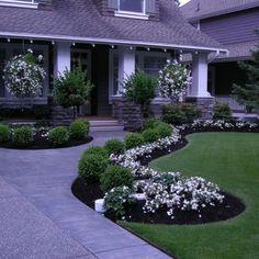 Flower garden alongside entrance path