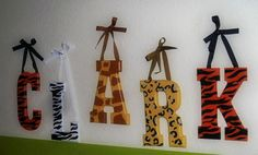 Modge podge animal print scrapbook paper to wooden letters (instead of painting) and hang from a branch?