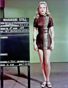 1955 Studio costuming test photo of Anne Francis as Alta for Forbidden Planet film, in a bold mini-skirt for the period.