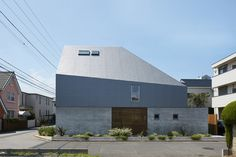 Architect Kentaro Ishida has completed a steel-plated house near Tokyo, featuring an asymmetric pitched roof designed to maximise sunlight for residents Minimalist Architecture, Japanese Architecture, Architecture Details, Interior Architecture, Interior Design, Arch House, House Roof, Small Buildings, Modern Buildings