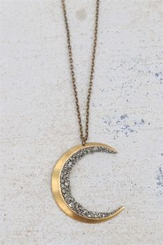"32"" necklace by Marly Moretti featuring a large brass moon charm adorned with crushed pyrite. Brass chain. Brass clasp closure. nec-1135c"