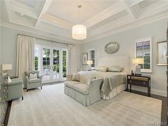 Dreamy gray grey master bedroom with ceiling beams - headboard - drum shade - Grey Oaks, Naples, FL