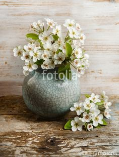 "Download the royalty-free photo ""spring background with flowers in a pot on wooden background with copy space "" created by stillforstyle at the lowest price on Fotolia.com. Browse our cheap image bank online to find the perfect stock photo for your marketing projects!"