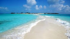 """""""An incredible beach of soft white sand surrounded on two sides by the Caribbean sparkling in all shades of blue."""""""