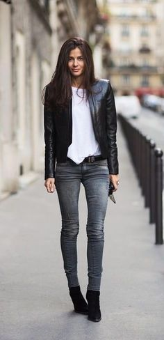 Pairing a black leather jacket with grey slim jeans is a comfortable option for running errands in the city. Round off this look with black suede wedge ankle boots.