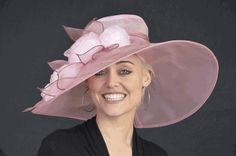 I think this is cute and may go with the lilac dress. Since I'm going to Norfolk, I would think big hats are acceptable for a wedding. Let me know.