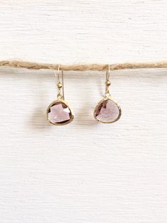 Purple Glass Earrings These are a pair of purple glass earrings set in gold. The earrings make a great bridesmaid gift, or for a bride to match to her bridesmaid's dresses. The best part is that they can also be worn as everyday earrings and can be worn all year round.  Spring/Summer colors to mix and match: purple, lavender, lilac, periwinkle  How to wear in spring/summer: A bridesmaid dress for a wedding or a nice sun dress with any shade of purple.