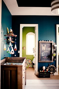 I absolutely LOVE the shade of blue of these walls.  I wish I new the paint brand and color name.  I REALLY WANT this collr for our front room!