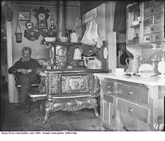 Oh my ...beautiful stove, Hoosier, drying rack, and more ♥ ...Emory Evans in his kitchen, early 1900s (Claude Taylor, photo)