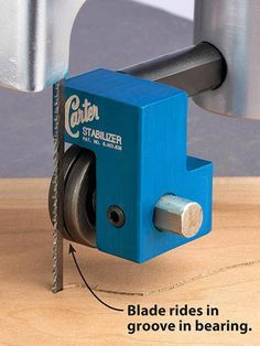"""Amp up your bandsaw #6: A specialized guide bearing helps narrow blades (1/8"""" and 1/16"""") track true during curved cuts. The rear of the blade rides in a groove in the bearing's edge. The groove provides side-to-side support and the bearing reduces friction."""