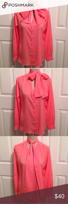 """ALMOST GONE✔️NWT Banana Republic  Scarf  Blouse NWT, Banana Republic Coral Blouse with High Back Neck & Attached Scarf. Gorgeous Scarf can be tied in a Bow or down Neckline. V neckline has front button down panel with front shoulders etched in pleats & mini mid back panel pleats. Fabric is 100% (NOT SHEER), Polyester, machine washable. Long sleeve button cuffs can also roll up with an attached inside button on strap (see last pic). ✅SMALL • Chest 40"""", Waist 38"""" & Length 26"""".✅XXS • Chest 35""""…"""