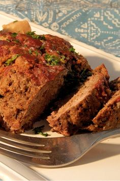 This flavorized slow cooker meatloaf is an easy meatloaf recipe! Cook the best meatloaf using ground beef, parmesan cheese, ketchup, Italian seasoning, and potatoes. You will love cooking this crockpot recipe for dinner!